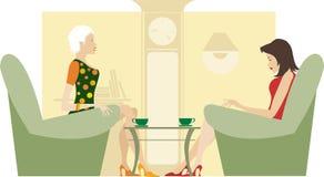 Zwei sitzende und sprechende Damen Stockbild