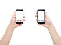 Zwei smartphones in zwei Händen lizenzfreies stockbild