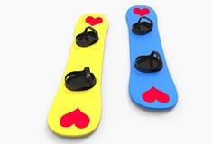Zwei Snowboards mit Herzen Stockfoto