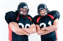 Zwei Spieler des amerikanischen Fußballs Lizenzfreie Stockfotos