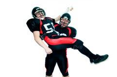 Zwei Spieler des amerikanischen Fußballs Stockbild