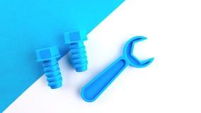 Zwei Spielzeugplastikbolzen und Schl?ssel blaue Farbe auf einem wei?-blauen Hintergrund lizenzfreie stockfotografie