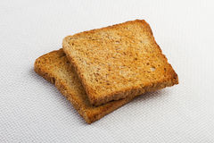 Zwei Stücke Toast auf dem Tisch Stockbild