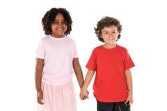 Zwei stattliche Kinder der verschiedenen Rennen Lizenzfreie Stockfotografie