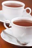Zwei Tassen Tee mit Saucers Stockbild
