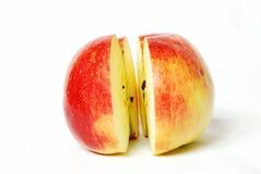Zwei Teile von einem Apfel Stockbilder