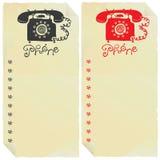 Zwei Telefonzeichen auf alten Papierkennsätzen Lizenzfreies Stockbild