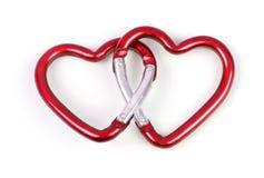 Zwei verbundenes Herz geformtes carabiner stockfoto