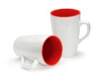 Zwei weiß und rote Becher lokalisiert auf weißem Hintergrund Stockfoto