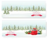 Zwei Weihnachtswinter-Landschaftsfahnen mit bunten Geschenken Stockbilder
