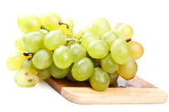 Zweig der grünen Trauben Lizenzfreies Stockfoto