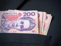 Zweihundert Ukrainer hryvnia in der Jacke Ihrer Taschenmänner Lizenzfreies Stockfoto