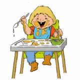 Zweijährige Jungenkarikatur hat Teigwaren in einem Hochstuhl, der Löffel verwendet Stockfotos