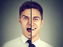 Zweipolige Störung Geschäftsmann mit doppeltem Gesichtsausdruck lizenzfreie stockfotografie