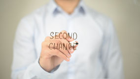 Zweite Chance, Mann-Schreiben auf transparentem Schirm Stockfotografie
