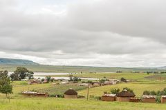 Woodstock dam, houses and small scale farming in Zwelisha. ZWELISHA, SOUTH AFRICA - MARCH 18, 2018: Houses and small scale farming in Zwelisha, next to road P288 Royalty Free Stock Image