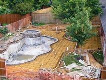 Zwembad in aanbouw stock fotografie