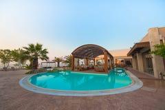 Zwembad van luxehotel Stock Foto