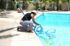 Zwembadreinigingsmachine Stock Afbeeldingen