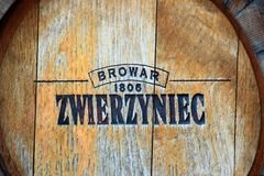 Wooden barrell with logo of brewery in Zwierzyniec, Poland. Zwierzyniec, Poland - May 3, 2018: Wooden barrell with logo of Zwierzyniec brewery, a part of Perla royalty free stock images