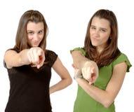 Zwillinge, die auf Sie zeigen Lizenzfreies Stockbild