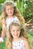 Zwillinge glücklich und traurig Stockbild