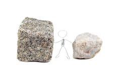 Zwischen einem Felsen und einem harten Platz Stockbilder