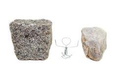 Zwischen einem Felsen und einem harten Platz Stockfoto