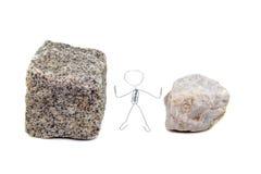 Zwischen einem Felsen und einem harten Platz Lizenzfreie Stockfotografie