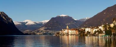 Zwitserland - Meer van Lugano. mening over Brusino. Stock Afbeelding