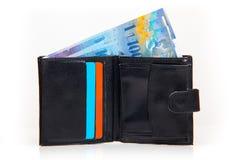 Zwitserse franken die met portefeuille betalen Stock Foto's