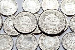 Zwitserse Franken en Rappen-muntstukken Stock Foto's