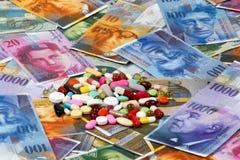 Zwitserse franken en tabletten Royalty-vrije Stock Foto's