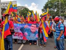 Zwolennicy Nicolas Maduro maszeruj? w Caracas upami?tnia? pierwszy rocznic? reelection obraz stock