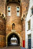 Arched opening of the Old city gate called the Sassenpoort in the historic hanseatic city of Zwolle. Zwolle, Overijsel/The Netherlands - Oct.23 2014: Arched stock photo