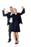 Zwycięska biznesowa para z rękami up Fotografia Stock