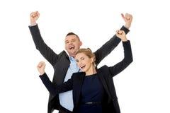 Zwycięska biznesowa para z rękami up Zdjęcie Royalty Free