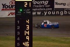 Zwycięzca jedzie błękitni 4 liczby akcyjnego samochód podczas bieżnego samochodu Obraz Stock