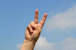 Zwycięstwo znak z dwa palcami Obrazy Royalty Free