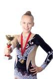 Zwycięzca gimnastyczki dziewczyny mienia nagroda Zdjęcia Stock