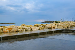 Zygi fishing village, harbour entrance from shore Stock Image