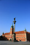 Zygmunt column in Warsaw against castle Stock Images