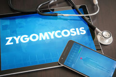 Zygomycosis (infectious disease) diagnosis medical concept. On tablet screen with stethoscope Stock Images