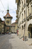 The Zytglogge in city of Bern. Bern, Switzerland - April 17, 2017: The Zytglogge in the old town can be seen at the end of a street . This medieval tower is one Royalty Free Stock Photos