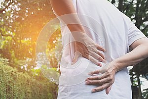 A man suffering from backache, spinal injury and muscle issue