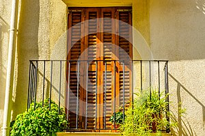 Stylish balcony with a metal railing, solid architectural element, a place of rest and relaxation, vintage decor