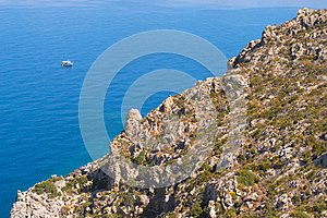 View on rock coastline and ocean from hiking trail on Greek island Telendos.