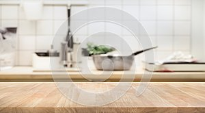 Wood table top on blur kitchen room background