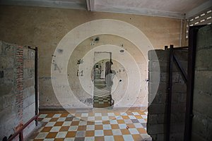 Room with plaid floor in Tuol Sleng Genocide Museum