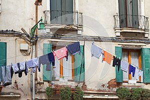 Typical view; the streets of Venice; washed clothes drying on cords outside the building, Venice, Italy co